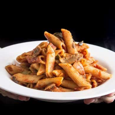 Make this Easy One Pot Pressure Cooker Penne Rigate Pasta Recipe in 30 mins! Comforting vegan pasta bursting with flavors. Great quick & easy dinner!