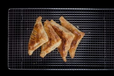 Easy Apple Turnovers Recipe - make these with only 4 ingredientsEasy Apple Turnovers Recipe (Only 4 Ingredients & 10-mins prep)! Flaky & crisp buttery puff pastry, bursting with warm cinnamon-spiced applesauce. Perfect Autumn desserts.