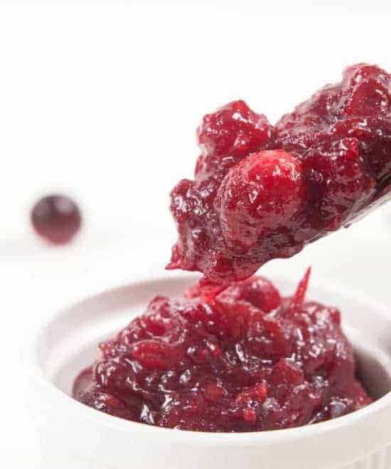 Easy Pressure Cooker Cranberry Sauce Recipe: Tangy & sweet fresh homemade cranberry sauce is great as a jam-like spread, topping for desserts, filling for pastries, glaze for meat, or extra flavor for yogurt/smoothie. Don't just save it for Thanksgiving dinner!