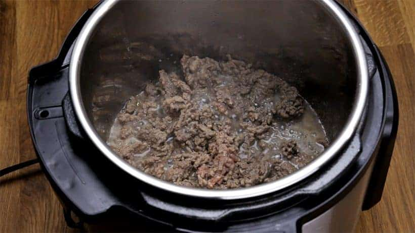 ground beef releasing meat juice while browning