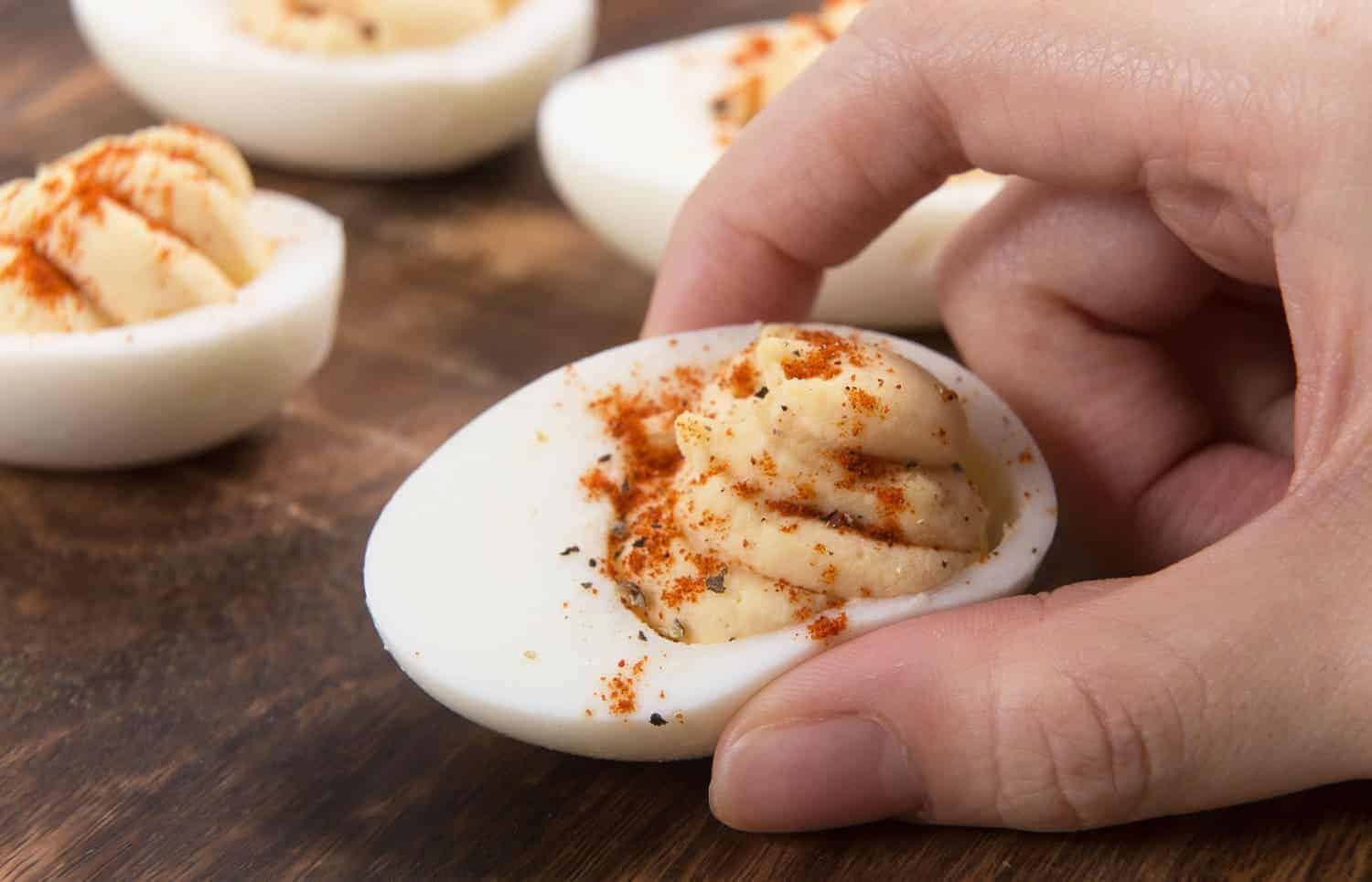 Instant Pot Deviled Eggs Recipe: Make creamy & rich Easy Deviled Eggs with a tad spicy twist! Our crowd-pleasing go-to party appetizer. Budget-friendly, simple & delicious.