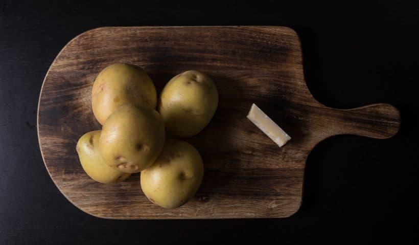 halve yukon gold potatoes, grate parmesan cheese