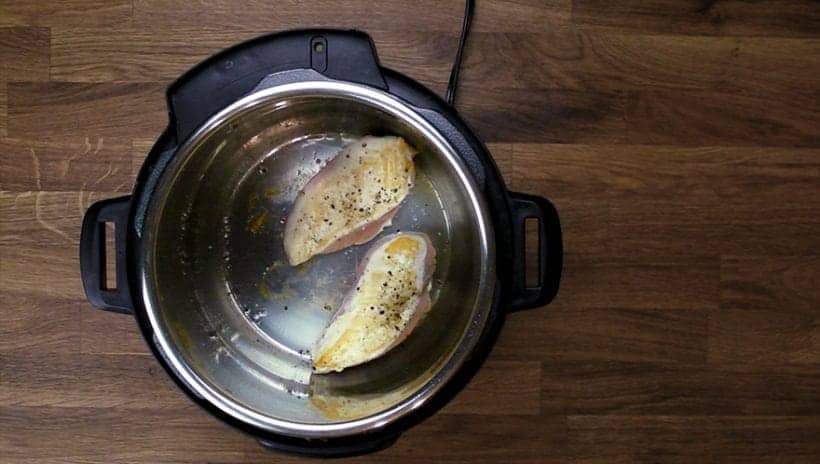 Instant Pot Spinach Chicken Alfredo Pasta Recipe: Browning chicken breasts in Pressure Cooker