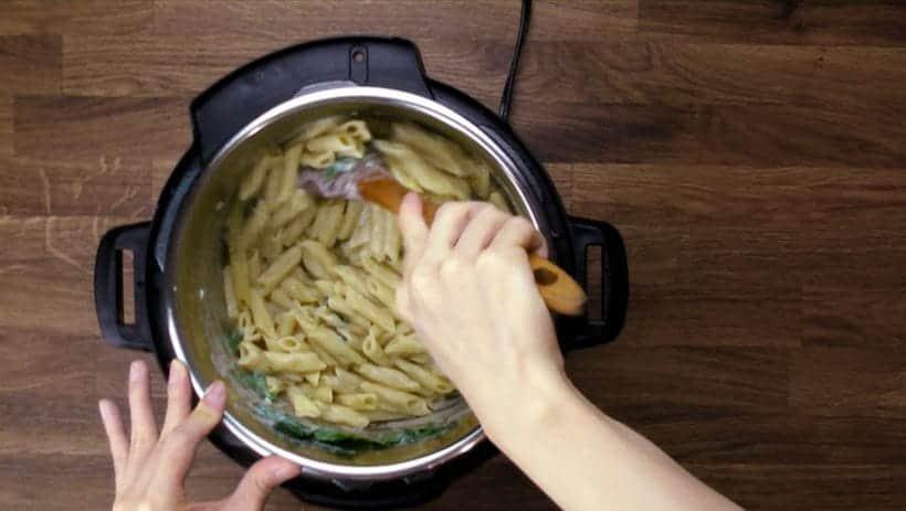 Instant Pot Spinach Chicken Alfredo Pasta Recipe: Mix in baby spinach & Alfredo sauce.