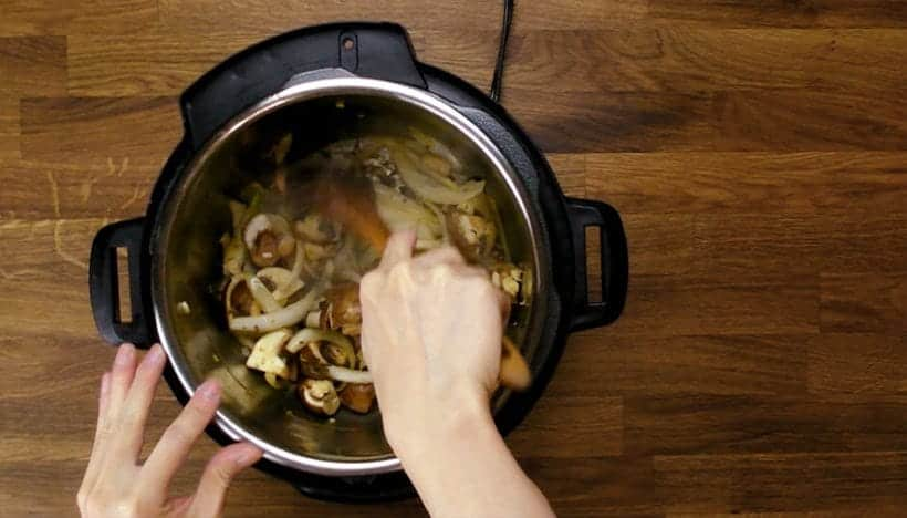 Guinness Instant Pot Irish Beef Stew and Mashed Potatoes Recipe: saute vegetables in Instant Pot Electric Pressure Cooker
