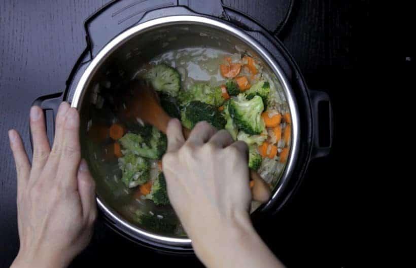 Instant Pot Broccoli Cheese Soup Recipe (Pressure Cooker Broccoli Cheese Soup): deglaze bottom of Instant Pot Electric Pressure Cooker with wooden spoon