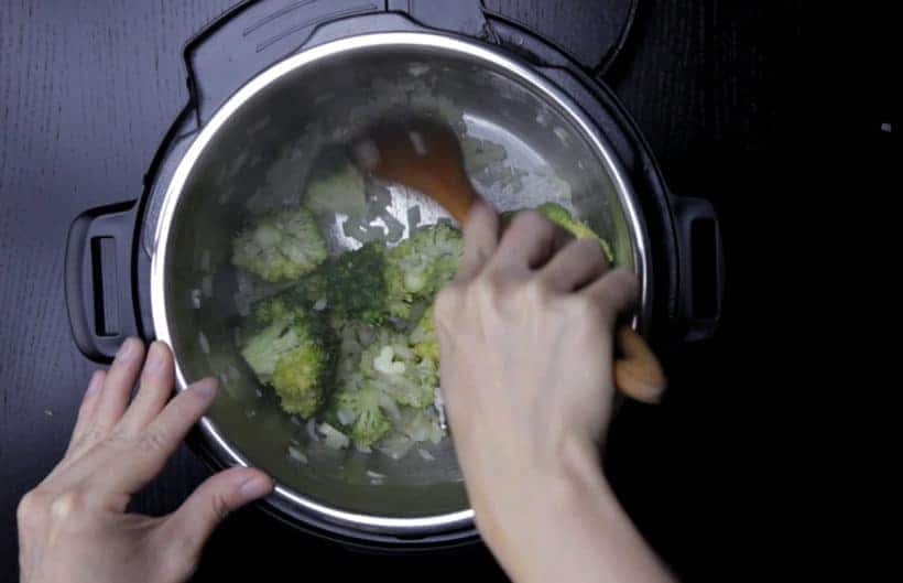 Instant Pot Broccoli Cheese Soup Recipe (Pressure Cooker Broccoli Cheese Soup): saute chopped broccoli in Instant Pot Electric Pressure Cooker