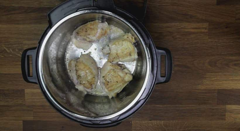 Quick & Easy Instant Pot Garlic Butter Chicken Recipe (Pressure Cooker Garlic Butter Chicken): flip and brown the meat side of chicken thighs in Instant Pot