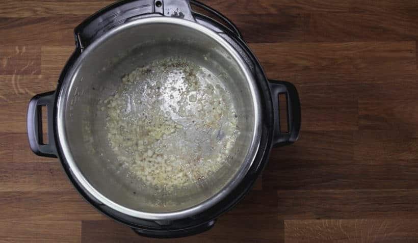 Instant Pot Tuscan Chicken Recipe (Pressure Cooker Tuscan Garlic Chicken): saute minced garlic in Instant Pot Pressure Cooker