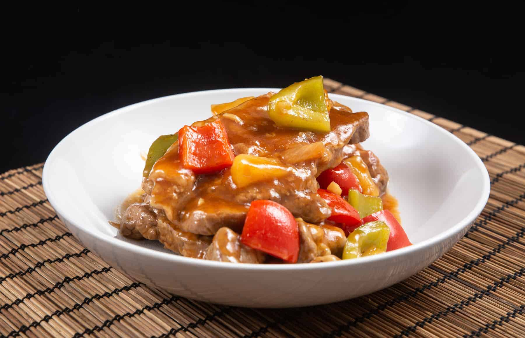 Instant Pot Sweet 'n Sour Pork Chops Recipe. Make this Top Selling Chinese Takeout: tender, juicy Pressure Cooker Pork Chops in a deliciously sweet and sour yummy sauce. Add this to your easy weeknight meal plan! #instantpot #instapot #instantpotrecipes #pressurecooker #recipes #chineserecipes #porkrecipes