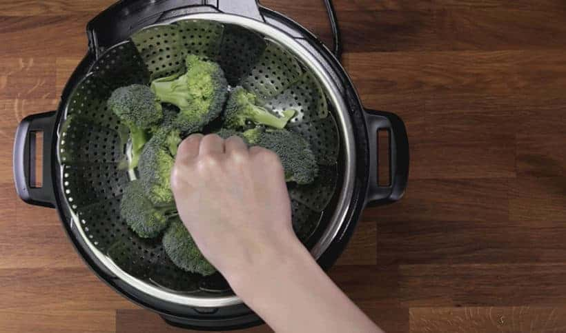 Instant Pot Broccoli Recipe: add steamer basket in Instant Pot with broccoli florets #instantpot #pressurecooker #vegan #vegetarian #recipe #keto #paleo
