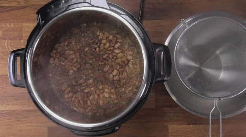 Instant Pot Refried Beans (Pressure Cooker) Recipe: strain pressure cooked beans with strainer #instantpot
