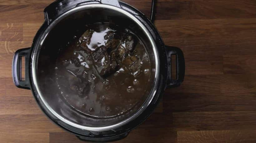 Instant Pot Short Ribs (Pressure Cooker Short Ribs): place pressure cooked short ribs back in Instant Pot Red Wine Sauce
