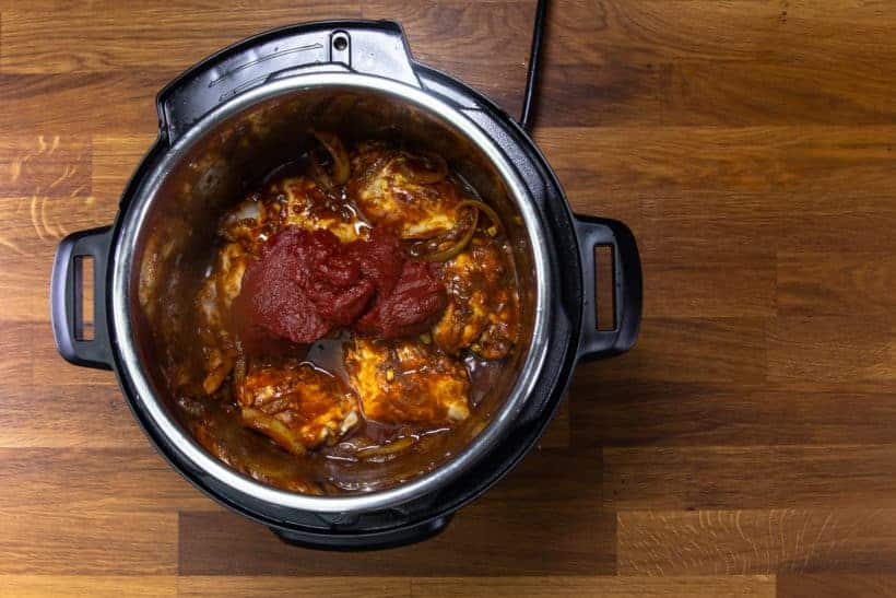 Instant Pot Butter Chicken: layer tomato paste in Instant Pot Pressure Cooker