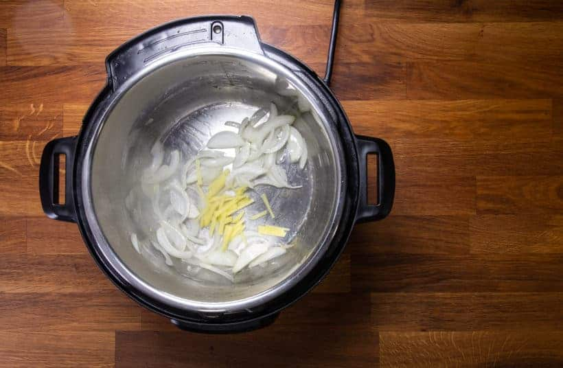Instant Pot Orange Chicken: saute onions and ginger in Instant Pot Pressure Cooker