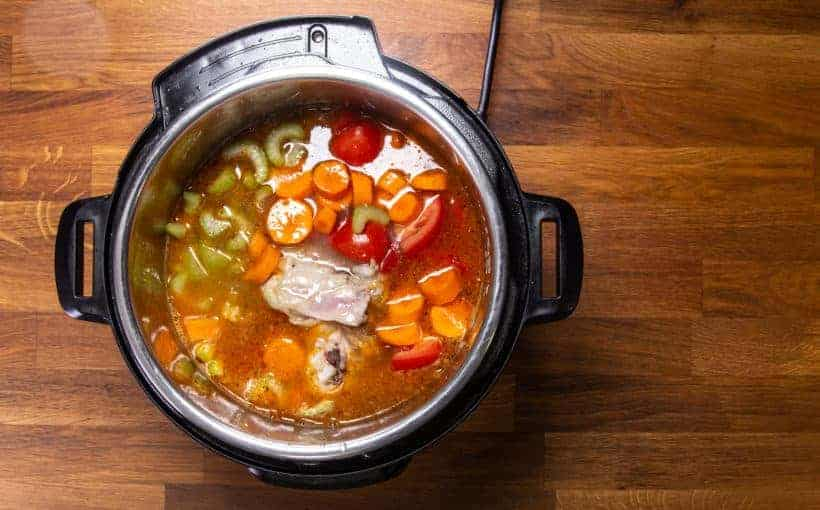 Instant Pot Chicken Soup | Pressure Cooker Chicken Soup: add chicken, celery, carrot, tomatoes, chicken stock in Instant Pot