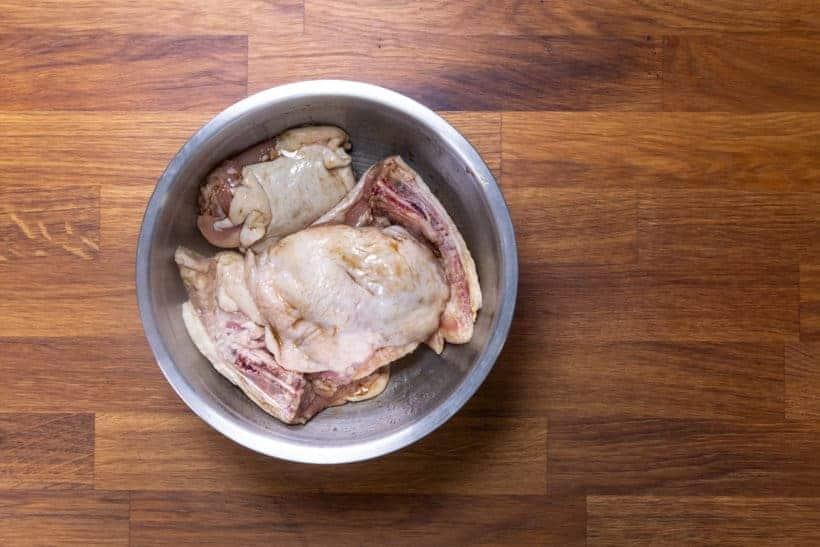 Instant Pot Orange Chicken: marinate chicken thighs in soy sauce, sesame oil