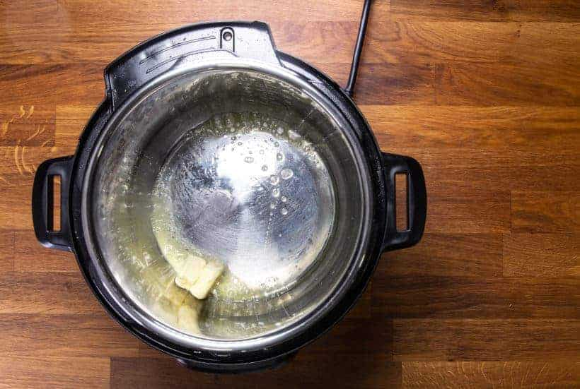 Instant Pot Roasted Potatoes: melt unsalted butter in Instant Pot Pressure Cooker