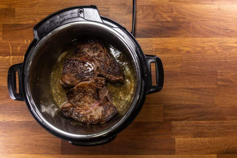Instant Pot Italian Beef | Pressure Cooker Italian Beef: add browned chuck roast in Instant Pot Pressure Cooker