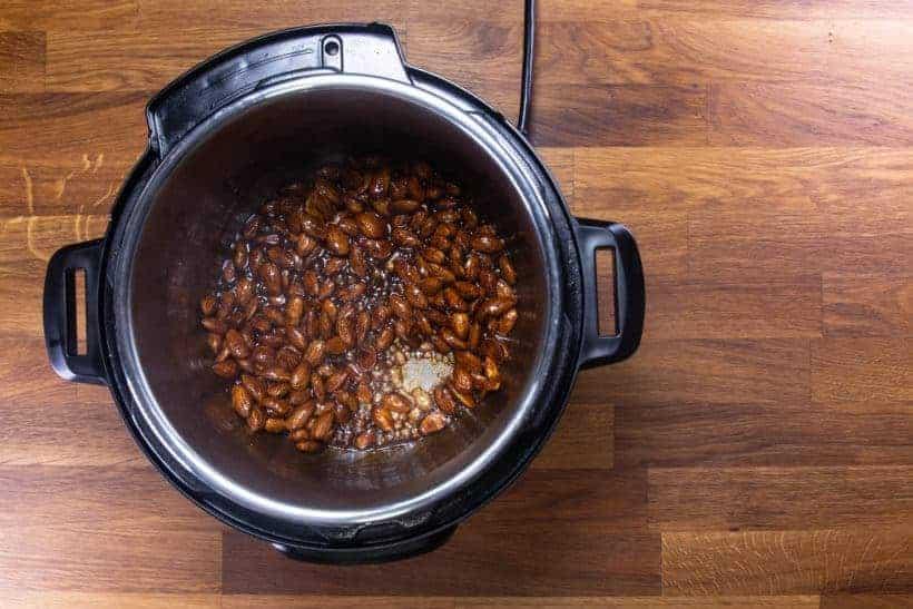 Instant Pot Churro Almonds | Cinnamon Candied Almonds | Caramelized Almonds Recipe: stir and coat almonds with cinnamon churro mixture