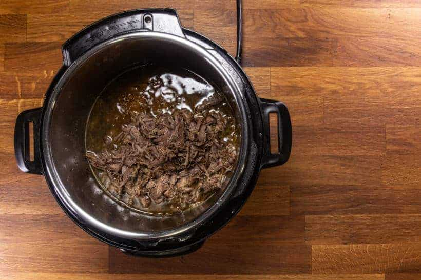 Instant Pot Italian Beef | Pressure Cooker Italian Beef: add shredded beef in Instant Pot Pressure Cooker