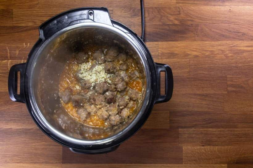 Instant Pot Zuppa Toscana Recipe | Pressure Cooker Zuppa Toscana Soup | Instant Pot Sausage Kale Potato Soup: saute minced garlic and thyme in Instant Pot Pressure Cooker