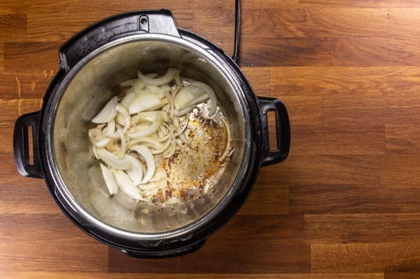 Instant Pot Italian Beef | Pressure Cooker Italian Beef Recipe: saute sliced onions in Instant Pot Pressure Cooker