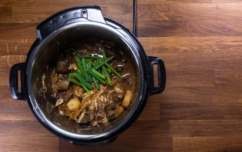 Instant Pot Chinese Lamb Stew | Pressure Cooker Lamb Stew: add green onion stalks to lamb stew in Instant Pot Pressure Cooker