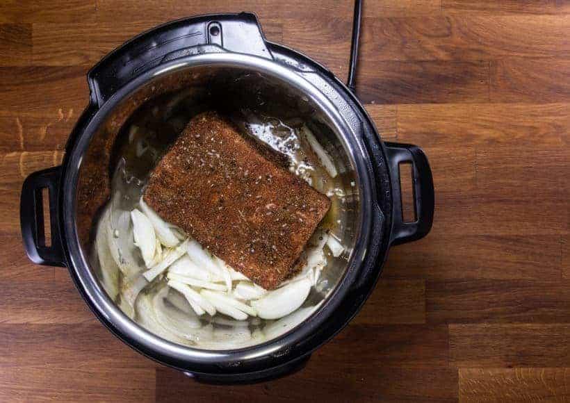 Instant Pot Brisket | Pressure Cooker Beef Brisket: place marinated brisket in Instant Pot Pressure Cooker