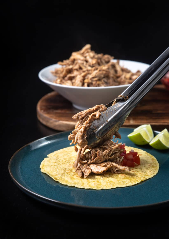 Instant Pot Chicken Tacos | Pressure Cooker Chicken Tacos: add shredded chicken, salsa pico de gallo, toppings on tortillas