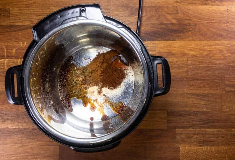 Instant Pot Chicken Tacos | Pressure Cooker Chicken Tacos Recipe: add spices, aromatics in Instant Pot Pressure Cooker