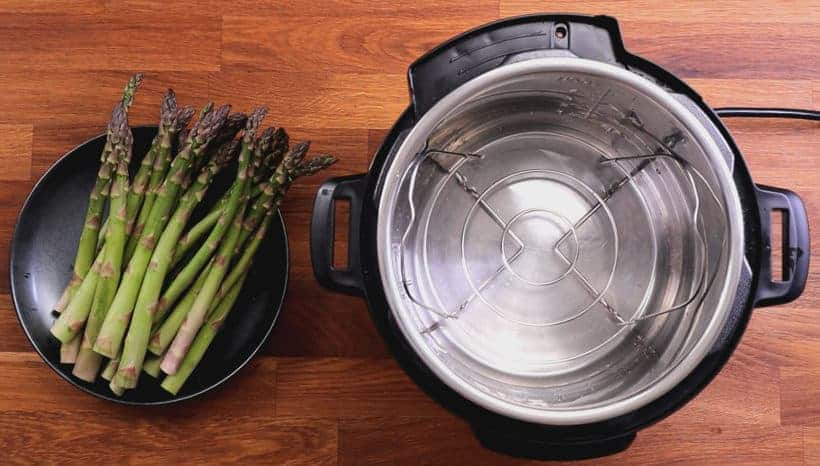 Instant Pot Asparagus: place steamer rack and water in Instant Pot Pressure Cooker #AmyJacky #InstantPot #recipes #PressureCooking