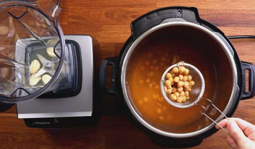 Instant Pot Hummus: drain chickpeas and cooked garlic from Instant Pot Pressure Cooker  #AmyJacky #InstantPot #PressureCooker #recipe #vegan #GlutenFree #vegetarian